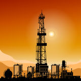 Silhouette Drilling Rigs. Silhouette Oil or Natural Gas Drilling Rigs on a Background of Mountains at Sunset,Silhouette Drilling Platform with Outbuildings and Royalty Free Stock Photos
