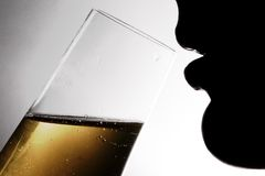 Silhouette of the drinking woman 1 Stock Photography