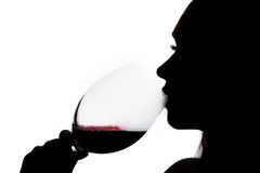 Silhouette of a drinking woman Stock Images