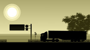 Silhouette of driving truck on highway Royalty Free Stock Photo