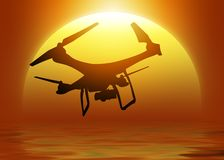 Silhouette of a drone with digital camera flying over the sun Royalty Free Stock Photos