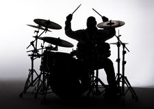 Silhouette of a Drummer. Silhouette of a male drummer in the studio Stock Image