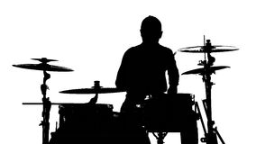Silhouette of the drummer and drums