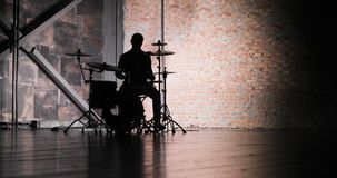 Silhouette of drummer man to play the drums. Anonymous Drummer Drumming on Stage stock video