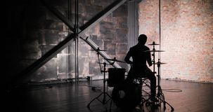 Silhouette of drummer man to play the drums. Anonymous Drummer Drumming on Stage stock video footage