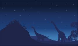 Silhouette du brachiosaurus deux avec l'étoile Photos libres de droits