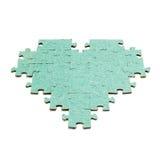Silhouette du coeur, faite avec des morceaux de puzzle Photos libres de droits