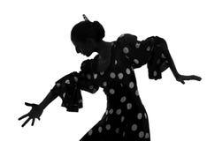 Silhouette du danseur espagnol de flamenco de femme dansant Sevillanas Photo stock