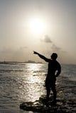 Silhouette du pointage de l'homme Photographie stock libre de droits
