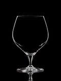 Silhouette du verre blanc de whiskey avec le chemin de coupure sur le fond noir Photos libres de droits