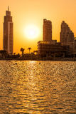 Silhouette of Dubai buildings . Silhouette of Dubai buildings with lake in the foreground Stock Photos