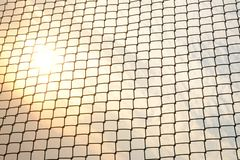 Close up metal fence with sunset and white warm sky background stock images