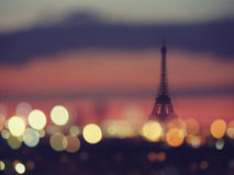 Silhouette of Eiffel tower and night lights of Paris, France. Vintage style travel background Stock Images