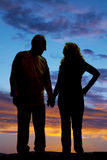 Silhouette elderly couple holding hands walk Royalty Free Stock Photos