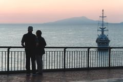 Silhouette elderly couple watching the sunset. sea ocean, concept of pension and vacation, travel in old age big ocean liner, royalty free stock images
