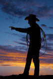 Silhouette elderly man rope cowboy point Royalty Free Stock Photography