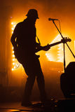 Silhouette of electric bass guitar player Stock Photography