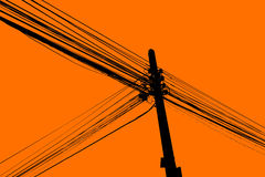 Silhouette of electric cable hanging on the pole Royalty Free Stock Photo