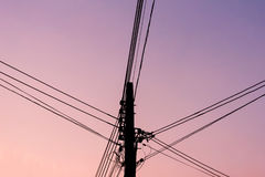 Silhouette electric pole. Stock Images