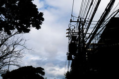 Silhouette, electric pole with have one transformers stock images