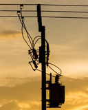 Silhouette of electric pole power lines and wires Stock Photos