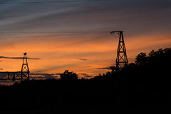 Silhouette of Electric Power Lines Royalty Free Stock Photography