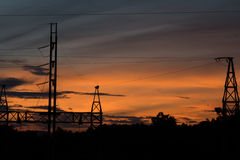 Silhouette of Electric Power Lines Stock Photos