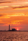 Electrical power plant against sunset. Silhouette of electrical power plant against sunset Stock Images