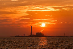 Electrical power plant against sunset. Silhouette of electrical power plant against sunset Stock Photo