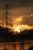 Silhouette electrical power tower with sunlight Stock Image