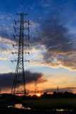 Silhouette electrical power tower with sunrise Stock Image