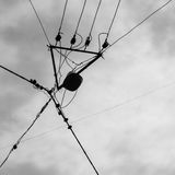 Silhouette of electrician aerial conductor Stock Images