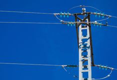 Silhouette electricity post on the background of blue sky royalty free stock photos
