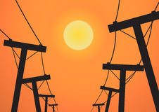 Silhouette electricity post before sunset Royalty Free Stock Photos