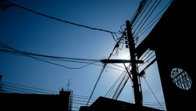 Silhouette of electricity post. And  wiring under blue sky Stock Photography