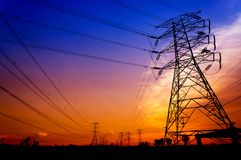 Silhouette electricity pylons Stock Photography