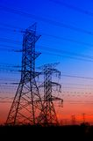 Silhouette electricity pylons Stock Image