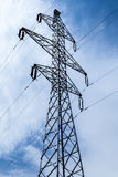 Silhouette of electricity pylons Royalty Free Stock Photo