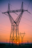 Silhouette electricity pylons Royalty Free Stock Photography