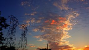 Silhouette electricity pylons in sunset background - ULTRA HD, 4k. Cable stock video footage