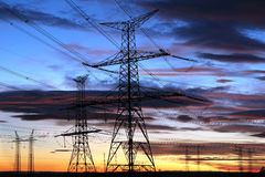 Silhouette of electricity pylons during sunset Royalty Free Stock Image