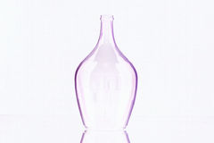 Silhouette of elegant old wine bottle. On a glass desk Stock Photos