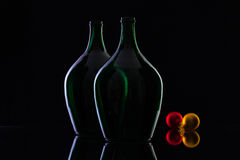 Silhouette of elegant and very old wine bottles and Christmas dec Royalty Free Stock Photography