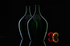 Silhouette of elegant and very old wine bottles and Christmas dec Stock Photos