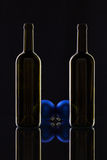 Silhouette of elegant wine bottles and Christmas decoration Stock Images