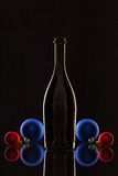 Silhouette of elegant wine bottles and Christmas decoration Royalty Free Stock Image