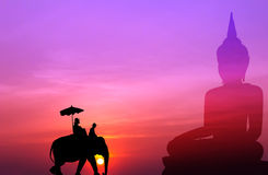 Silhouette elephant with tourist with big buddha background at s Royalty Free Stock Photos