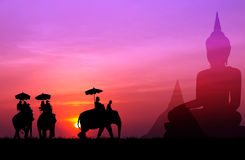 Silhouette elephant with tourist with big buddha and pagada back Stock Image