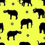 Silhouette of elephants Seamless pattern on yellow background,. Vector Royalty Free Stock Image