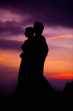 Silhouette of Embracing Asian Bride and Groom at Sunset Royalty Free Stock Photo